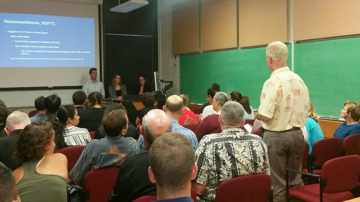 This is picture of the presentation at NDPTC's Third Thursday Event for June 2016. It shows the presenter answering a question from a gentleman in the audience.