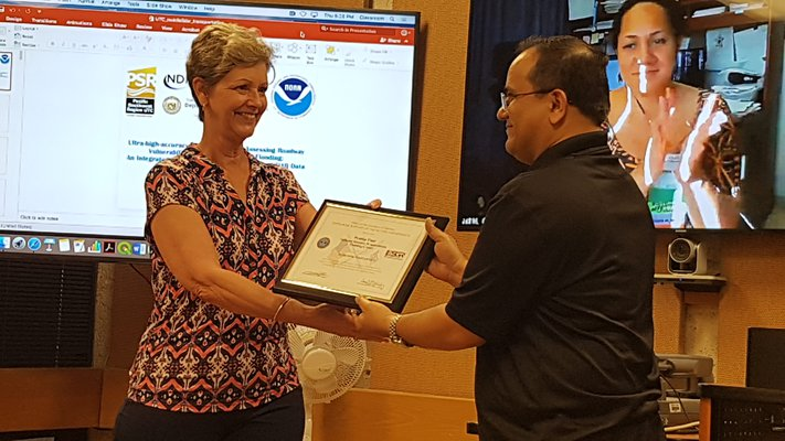 This is a picture of Dr. Pradip Pant receiving the ESGR Patriot Award