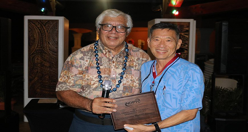 This is a picture of Dr. Karl Kim awarding Mr. Fuapopo Avegalio the 2019 NDPTC Community Resilience Award