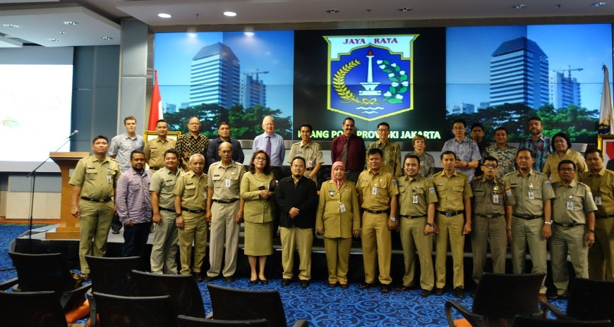 This is a picture of NDPTC Executive Director Karl Kim posing with individuals from the Indonesian government