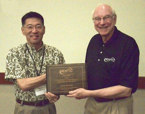 Dr Karl Kim Presents Dr Eddie Bernard with Award