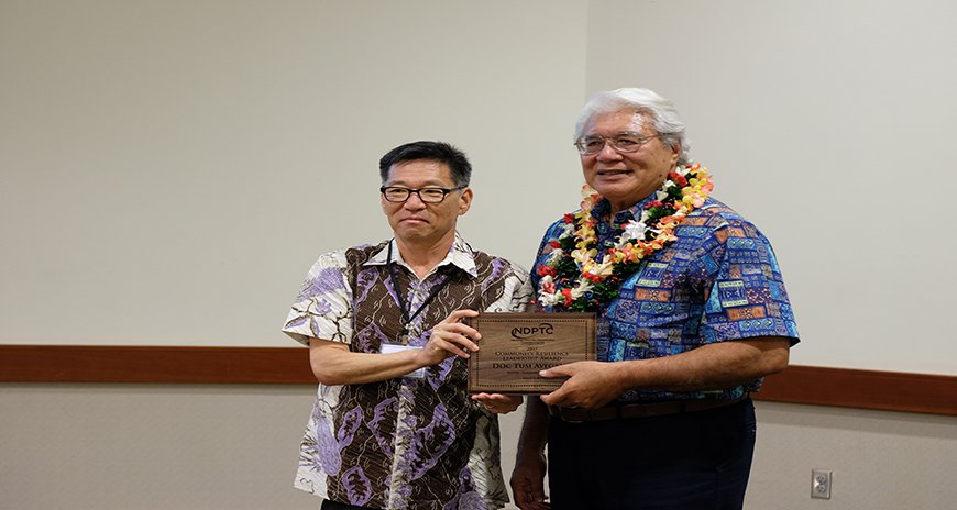 This is a picture of Dr. Karl Kim handing the NDPTC Community Resilience Award to Papali'i Dr. Failautusi Avegalio at the PRiMO 2017 conference