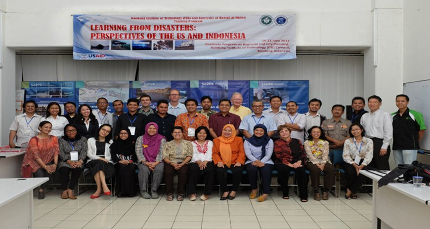 This is a photo of NDPTC's Karl Kim posing with the USAID training workshop class in Bandung, Indonesia