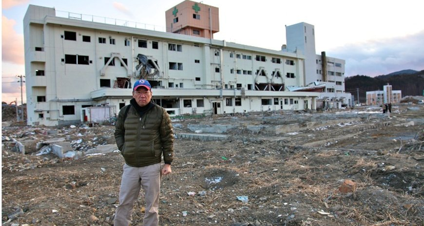 This is a photo of Dr. Karl Kim in Minamisanriku, Miyagi Prefecture after the 2011 Tsunami in Japan