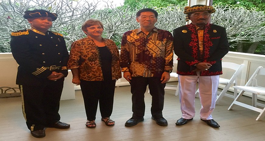 This is a photo of Dr. Karl Kim and Dr. Dolores Foley with the Sultan of Tidore