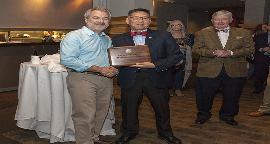This is a photo of the Karl Kim giving Jim Fernandez an award for all his service to the National Domestic Preparedness Consortium