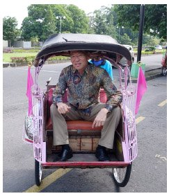 This is a picture of Dr. Karl Kim in Indonesia riding a rickshaw