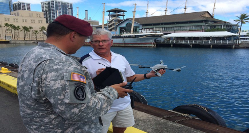 This is a photo of NDPTC SME Ted Ralston demonstrating a UAV to a member of the 97th Civil Affairs at SOPAC